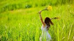 8726281-woman-in-white-dress-triwls-in-field-with-flowers-in-hand-summer-carefree-girl-Stock-Pho.jpg